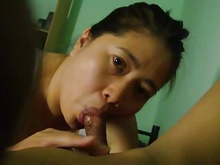 Older Asian woman sucking