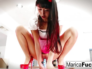 Marica Hase uses a glass toy